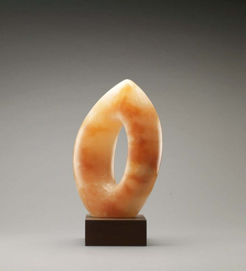 ART FOR FILM - great cleared art rental for film, television and commercials sculpture orange alabaster with mahogany base