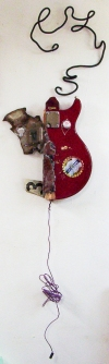 3D / Encaustic / Collage / Assemblage guitar  and scrap car parts, encaustic, pacifier, and various plastic coated wires