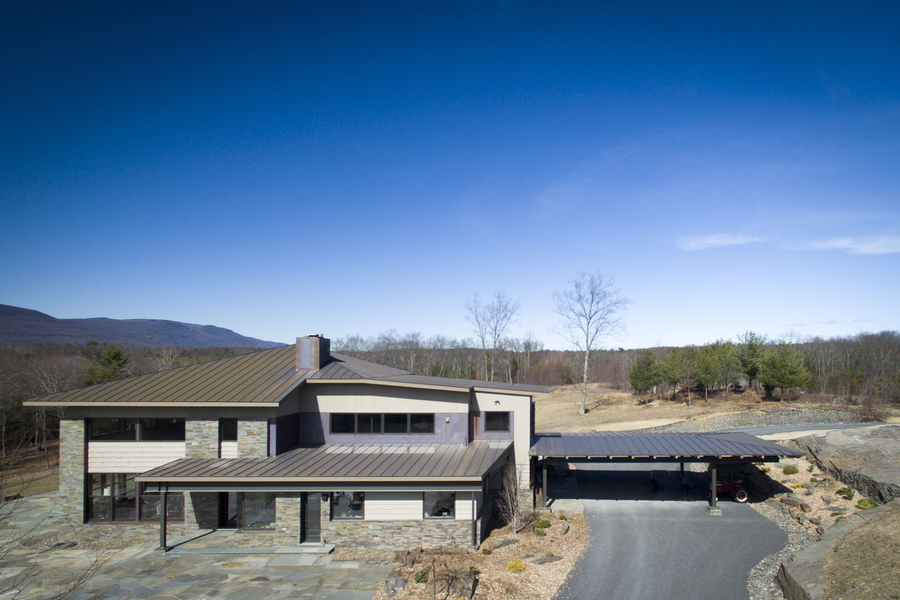 High Performance Homes Exposed Steel Supports, Blue Stone Veneer, Copper Roofs