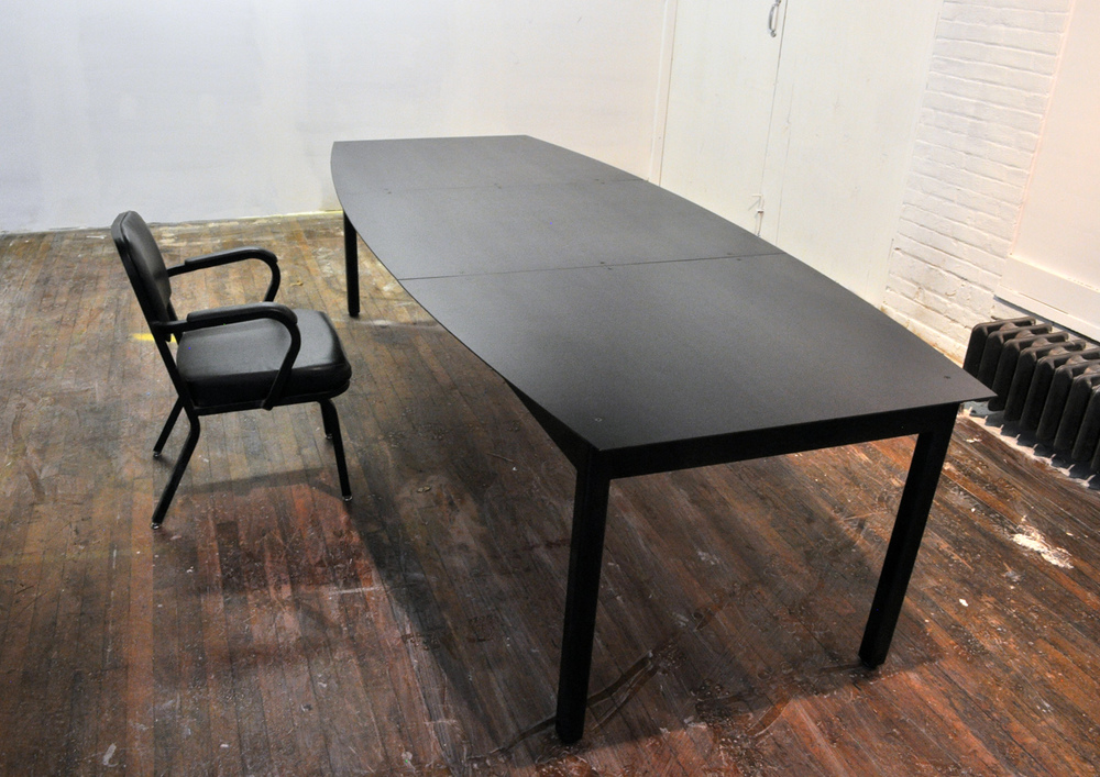 Blackened steel conference table