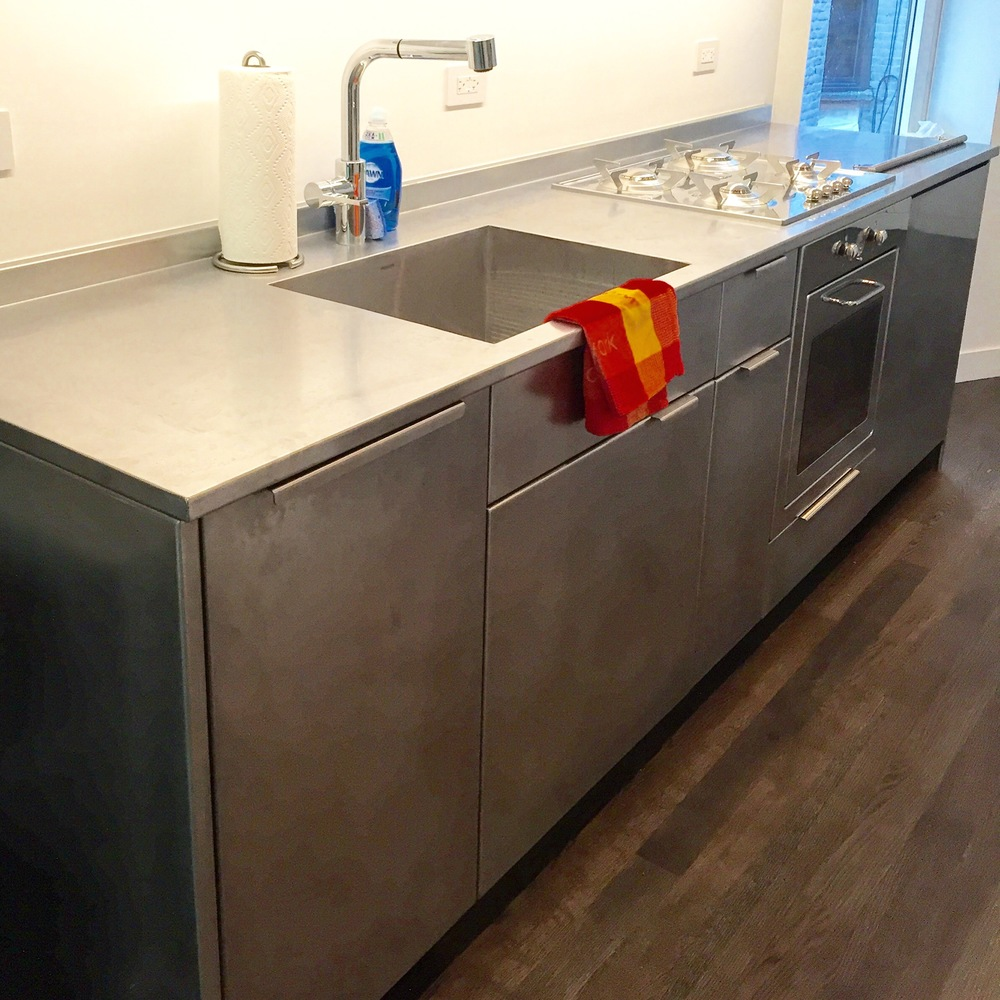 stainless steel cabinetry and countertop
