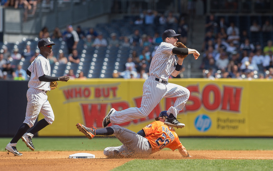 Sports NY Yankees' Stephen Drew turns a double play