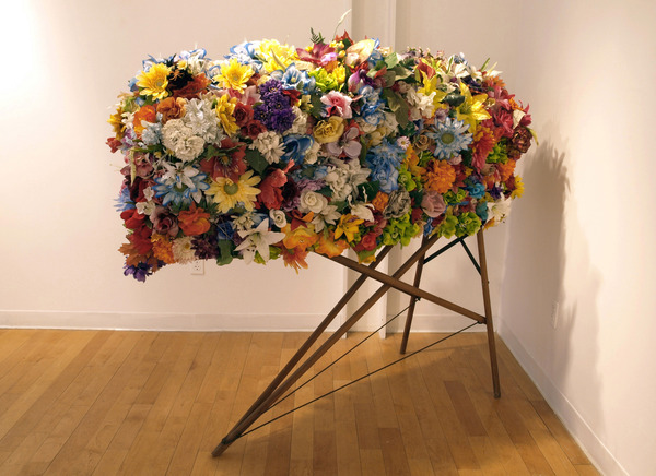 Charles Goss Everything I Don't Know discarded cemetery artificial flowers, ironing board