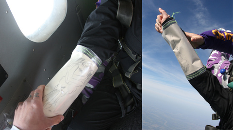 Christie Blizard jumping out of an airplane with a deKooning Drawing