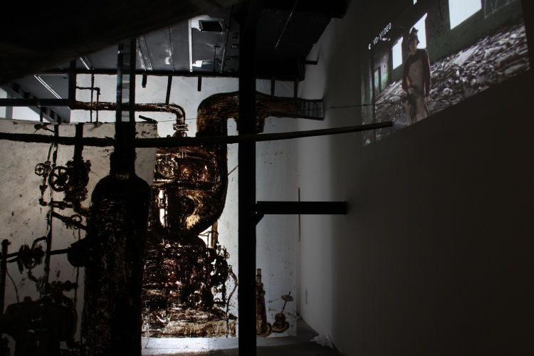 Cindy Tower Happenings/Performed Sculpture Video Installation with projected factory inhabitants.