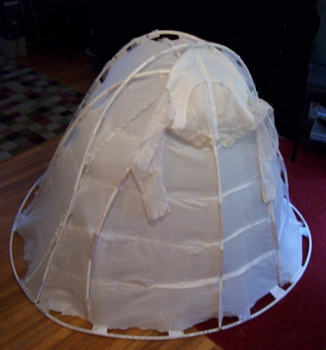 Cindy Tower Happenings/Performed Sculpture 4'x4'x6,, wedding dress and supports, tent stakes