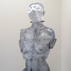The Human Form Cast glass, powder coated steel base, rubber, wood, iron rod and chain, iron weight, oil paint