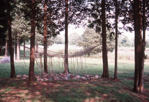 Marcia Cooper BETWEEN the Trees Mixed media installation with ropes, netting,stones, pottery