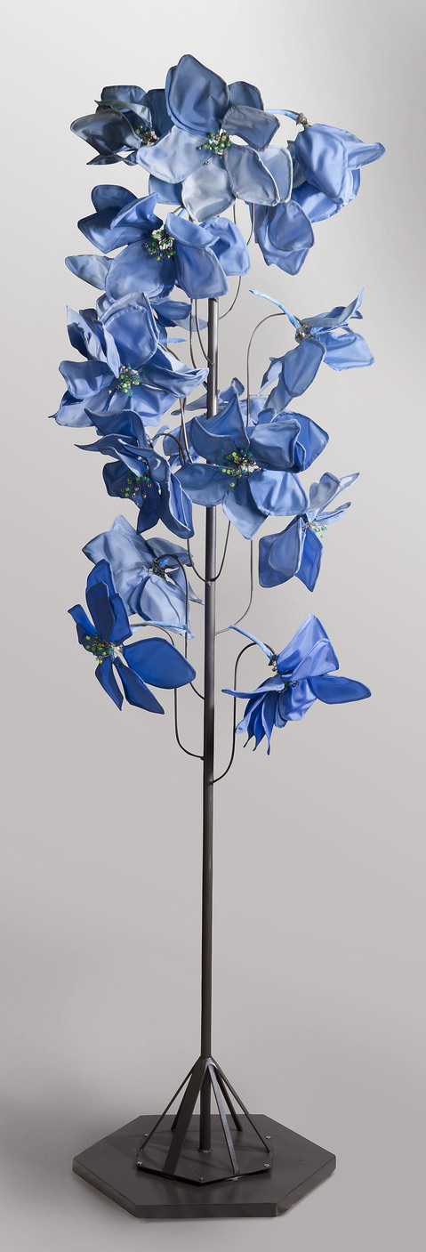 Daina Shobrys Larkspurs and Delphinium Plastic banner fabric, beads, adjustable hose clamps, heat-bent pvc pipe.