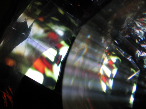 Daniel Healey Video Sculpture t.v. monitor, stool, mirrors, fresnel lens, mylar, tape, cardboard, light, video