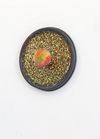 Improbable, LVL3 gallery.  Paint jar lid, resin, glitter, pompom