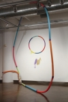 Split Ends (MFA thesis show) Found hoop and piece of furniture, spray paint, tape and swimming pool noodles.