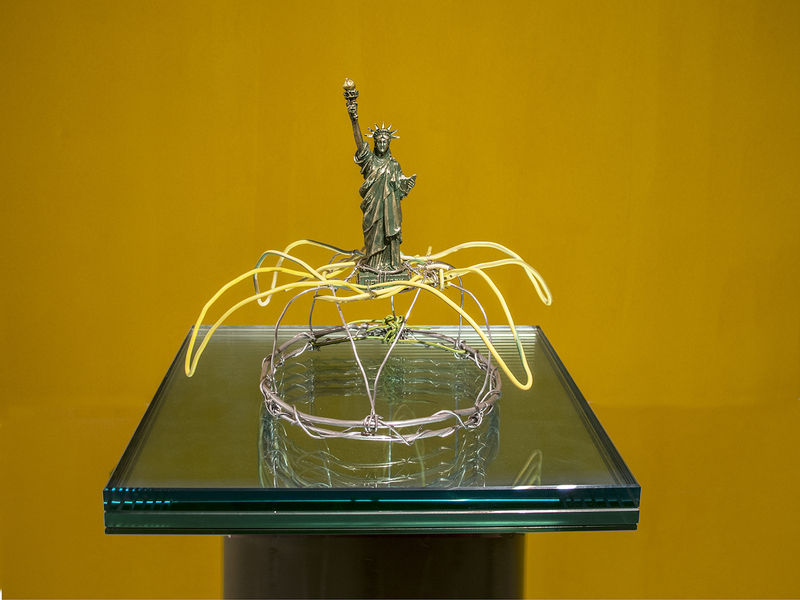 Eleni Mylonas  Head Pieces Liberty effigy, armature, electrical cable, trash, mirror, glass, sewage pipe.