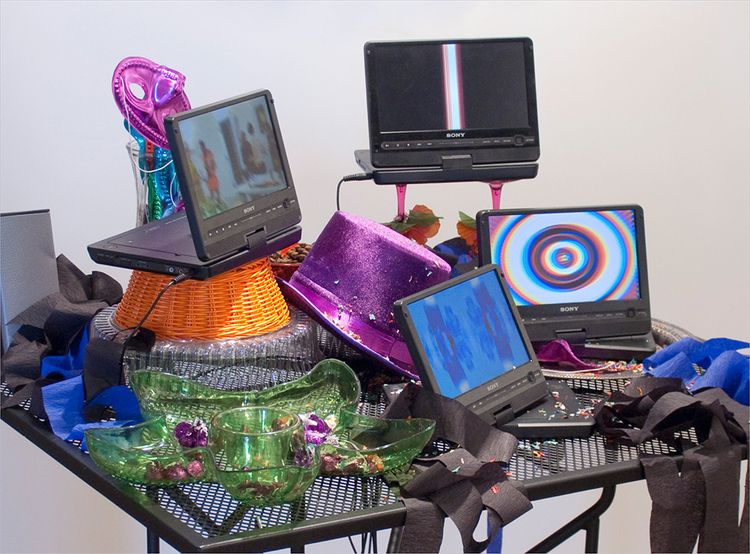 Elizabeth Riley Art with Video Media<BR> 2009-2010 Table, 4 DVD players and video, party accoutrements