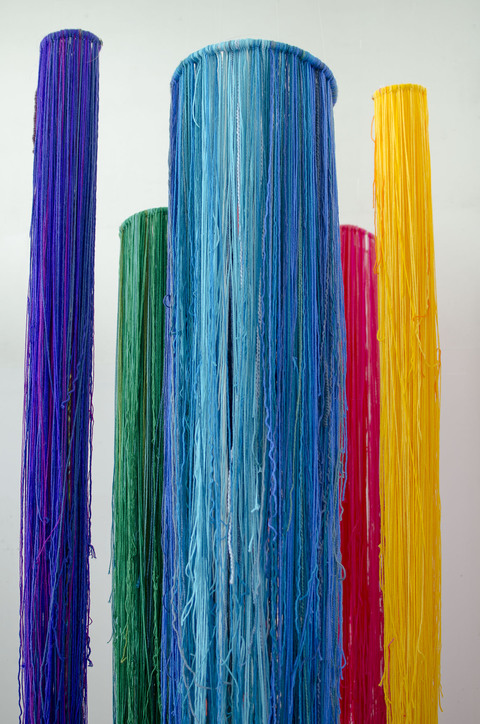 EMMA BALDER Color Bomb Yarn and various string suspended from ceiling