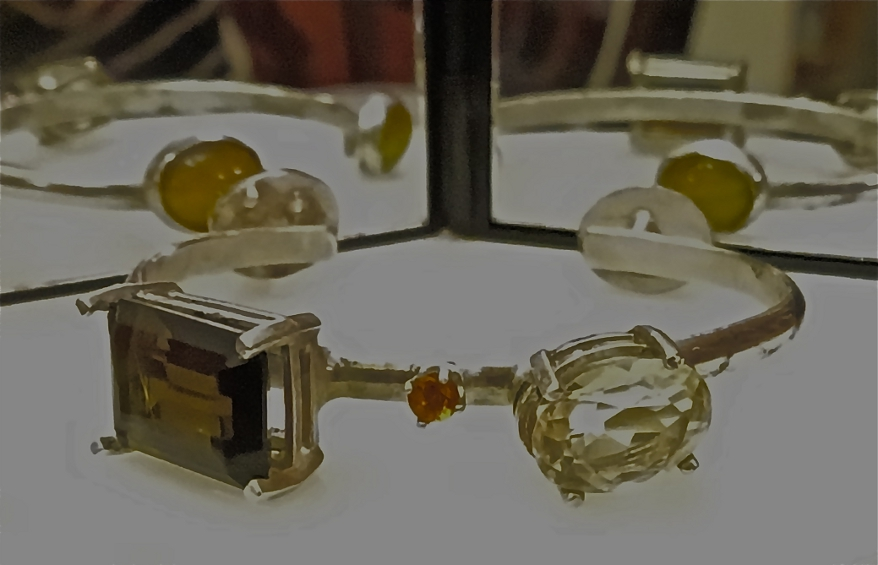 Digital Files of Artists Emily Rollman; Multi-Topaz and Amber Cat's Eye Bangle; Recycled Sterling Silver, Different Topaz Pieces, Amber Cat's Eyes