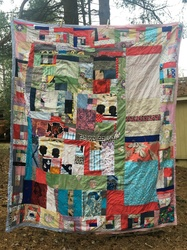 Ginna Triplett 2016/2017 Patchwork quilt made from different fabric including pieces of fabric with woodcuts printed onto them, embroidery floss, quilt batting.
