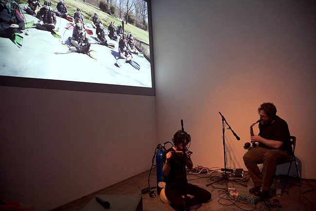 HOPE GINSBURG Breathing on Land: Duet for Scuba and Saxophone, 2015 Performance documentation