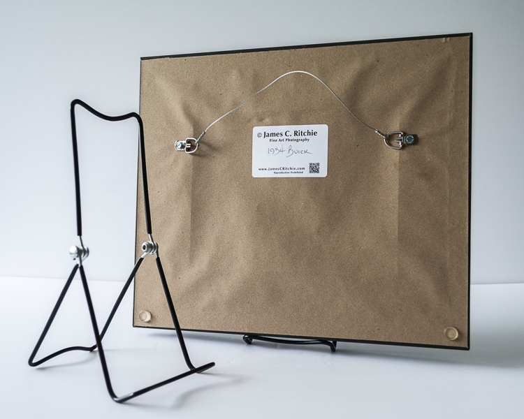 Product Details The frame backs are finished with a heavy kraft paper dust shield, wall bumpers, and hanging wire already installed. Also included is one black vinyl-coated, adjustable 3-wire easel for easy display on a shelf, table, or desk.