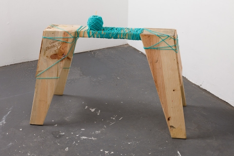 jane hugentober 2012 third trimester wooden sawhorse, ink, yarn, and tapestry needle