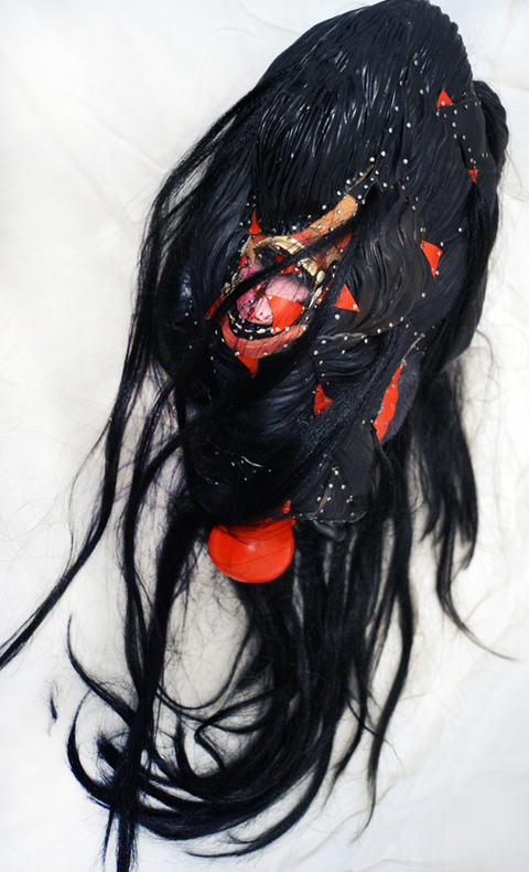 JANICE SLOANE Heads 2007-17 vinyl halloween masks, plastic bags, artificial hair, steel pins, styrofoam
