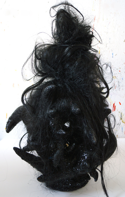 JANICE SLOANE Heads 2007-18 vinyl Halloween masks, plastic bags, steel pins, artificial hair, acrylic paint, glitter