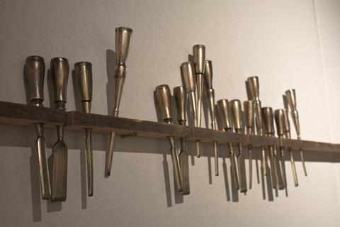 Sculpture Drywall, Cast Bronze (Including 30 sharpened cast bronze chisels, 1 cast drawknife, and 2 cast scribbles), Wood ( walnut, chestnut, and cherry), Brass, C Clamps, Shop Light