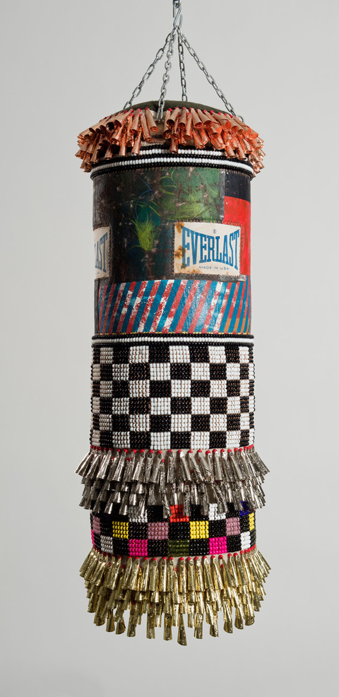 Both Hands  found canvas punching bag, recycled wool blanket, artist's own repurposed painting, glass beads, artificial sinew, tin jingles, nylon fringe