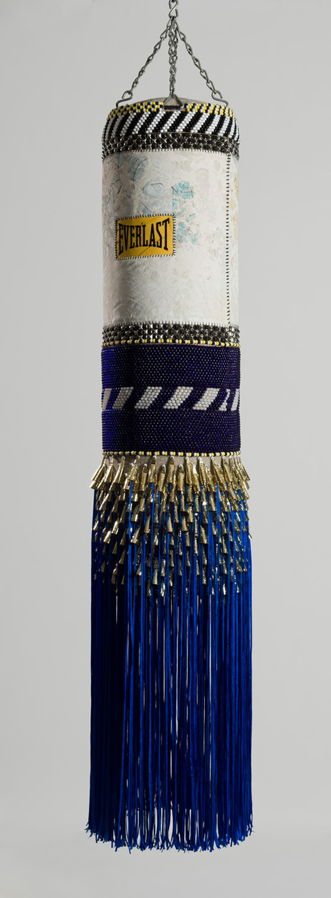 Deep Blue Day found vinyl punching bag, recycled wool blanket, artist's own repurposed painting, steel studs, tin jungles, nylon fringe, artificial sinew