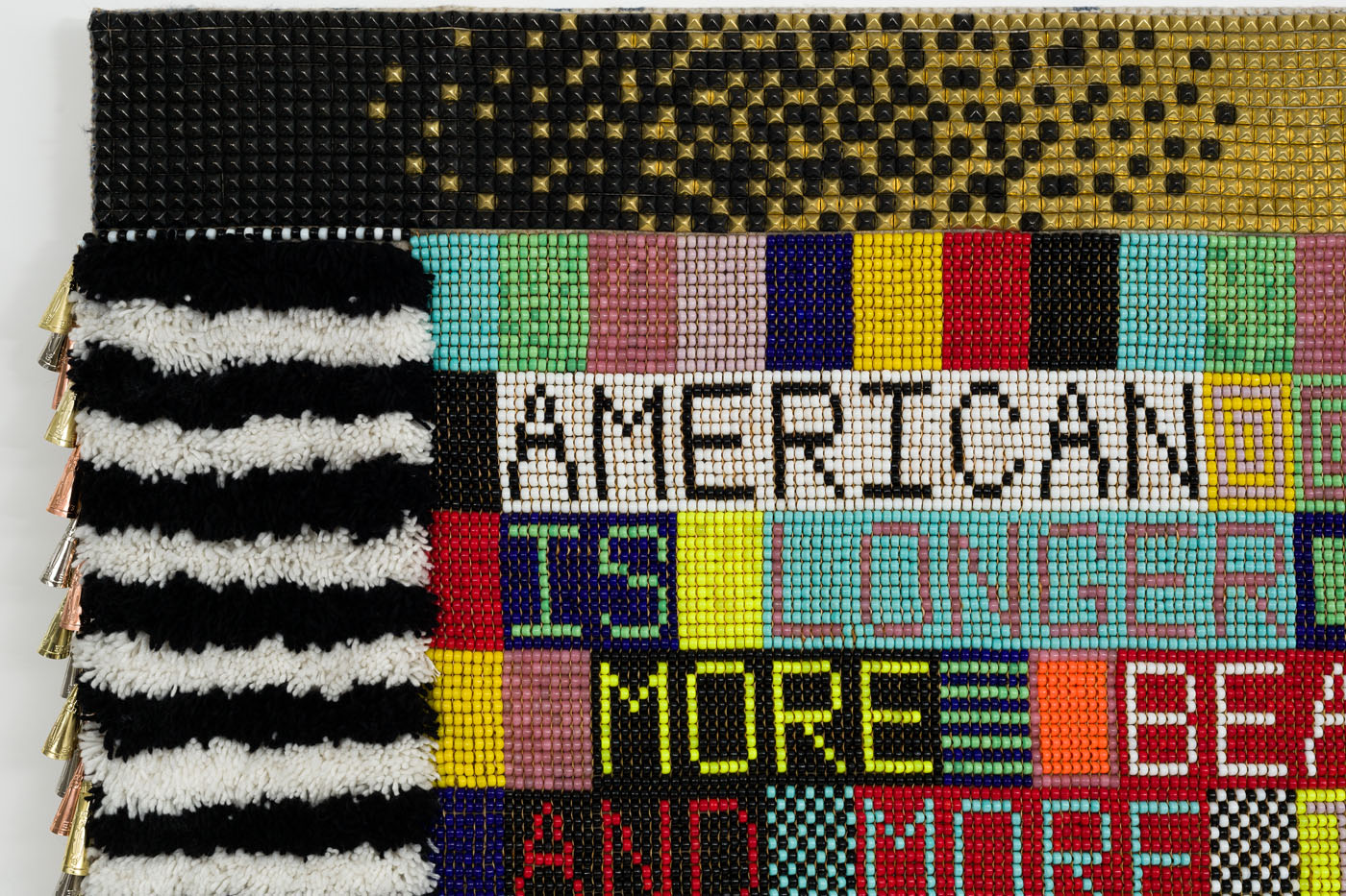 AMERICAN HISTORY (JB) wool, steel studs, glass beads, Artificial sinew, metal jingles, acrylic yarn, nylon fringe, canvas
