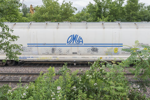 Train car labeled for OMYA, the Swiss Corporation that owns the Danby Quarry and leases it to R.E.D. Graniti, an Italian Corporation, Rutland, Vermont