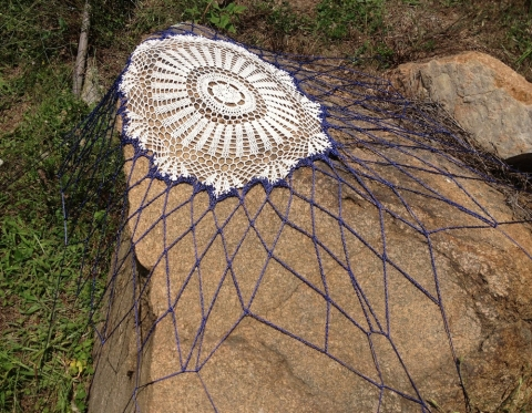 s i t e specific cotton doilies stretched on found rock