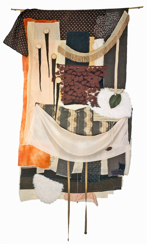 JoAnne Lobotsky Fiber Works (textile and paper) 2015-2019 Boro fabric, vintage silk, other fabric, faux fur, machine and hand embroidery, artificial leaf, suspender strap, stuffing in places, wood discs, hanging from a dowel.