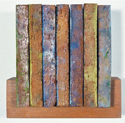 Jodie Manasevit Bricks and Wedges 1991-93 Oil on paving stones on wood shelf