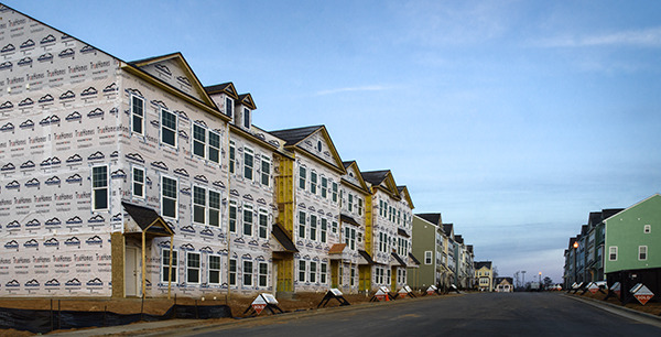 The Urban Landscape:  Goodbye to Fields and Farms--Out with the Old, In with the New Town Homes on the Hill  ©