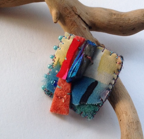 Fiber & Jewelry Handpainted silk, synthetic fiber, felt, glass beads, crystal, thread