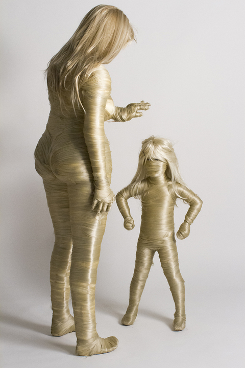 Standing hair lady and child