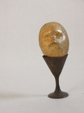 Eggs plaster, bronze base, gold leaf