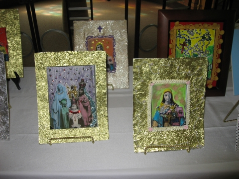 OLL Restoration Workshop Artwork made by the group.  The group also made artwork for the candidates using found objects and decorating photograms of religious statuary.  The gold frames were made from the foil from the potted Christmas pointsettias that decorated the church!