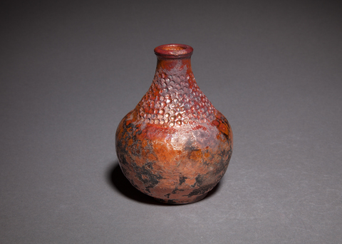 Bottles and Vases Wheel thrown and altered raku fired red stoneware clay with gold glaze sake bottle, small vase