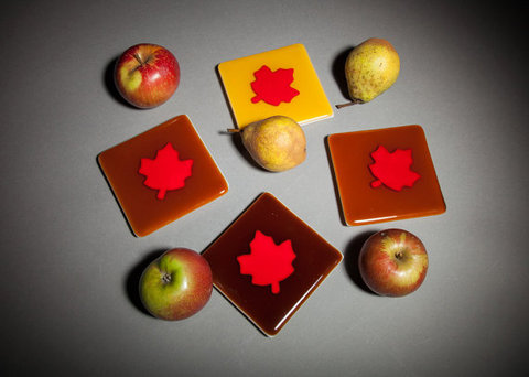 Glass Ware Thanksgiving dinnerware fused glass set of autumn leaves coasters with glass feet in caramel, burnt sugar and butter scotch colors.