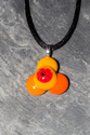 Orange, red and yellow trefoil fused glass pendant necklace