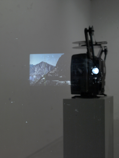 Marc Handelman Geological Sketches at Home and Abroad Glass, oil paint, 16mm projector with looper, color 16mm film (2 min), pedestal and hardware
