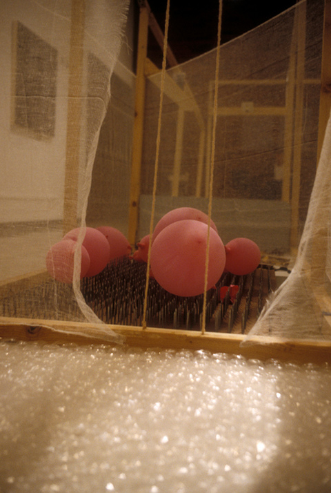 Margaret Keller Passages Series Installation detail, bed of nails, balloons, bubblewrap