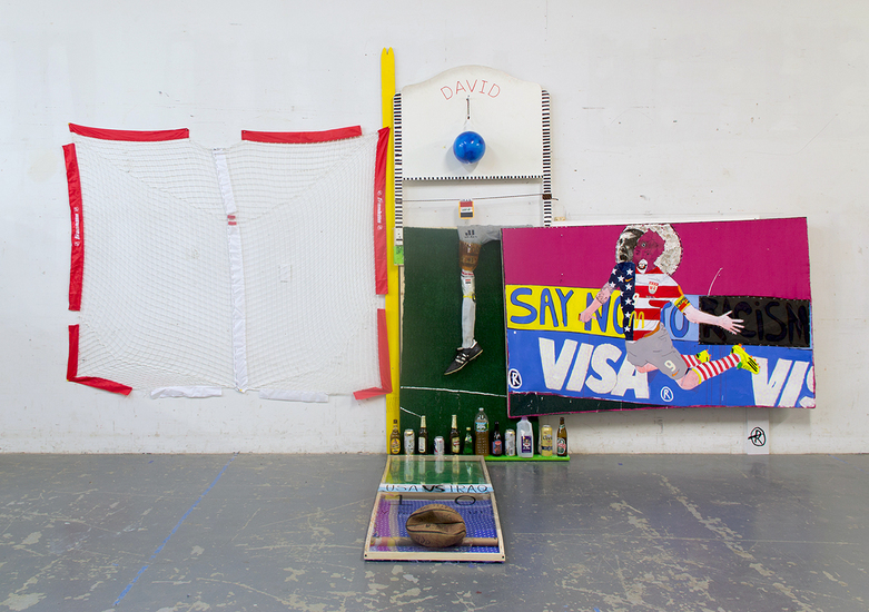 MIKE SHULTIS Champs (2014)  Oil, Acrylic, Ink, Silver Leaf, Bed Sheet, Astroturf, Vinyl, Wood, Assortment of Used Bottles, Photo Transparency, Found Basketball, Hockey Nets, My Used Underwear and Soccer Cleat