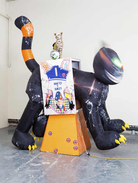 MIKE SHULTIS Funny Money (2016-17) Mixed Media, Taxidermy Bobcat, and 11' Inflatable Cat on Stolen Construction Cone and Table