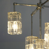 Michelle James NYC  <br/>MATERIALS:  brass, UL listed electrical components, 5 vintage cube globes, 2 vintage jewelry elements<br/>