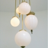 Michelle James NYC  <br/>MATERIALS:  5 repurposed vintage milk glass globes, brass, UL listed electrical components<br/>