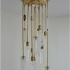 Michelle James NYC  <br/>MATERIALS:  brass, UL listed electrical components, 5 repurposed vintage glass globes, vintage glass elements used as jewelry<br/>