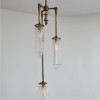 Michelle James NYC  <br/>MATERIALS:  brass, UL listed electrical components, 3 repurposed vintage glass globes, vintage glass elements used as jewelry<br/>